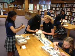 Seventh graders searching through primary documents from our archives.